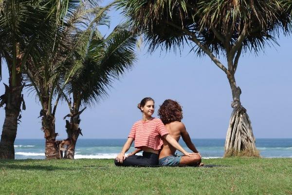 SEATED TWIST – Parivrtta Sukhasana (Yoga poses for two people)