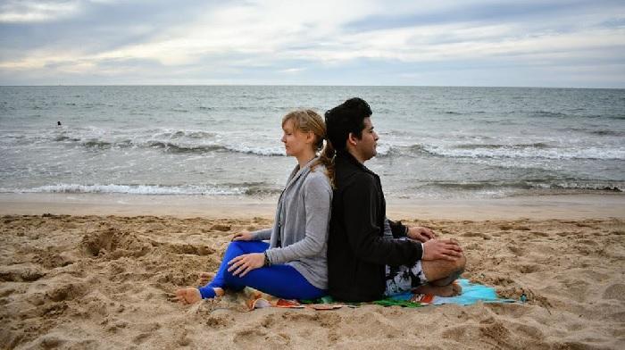 couple doing SEATED MEDITATION – Sukhasana- yoga poses for 2 people