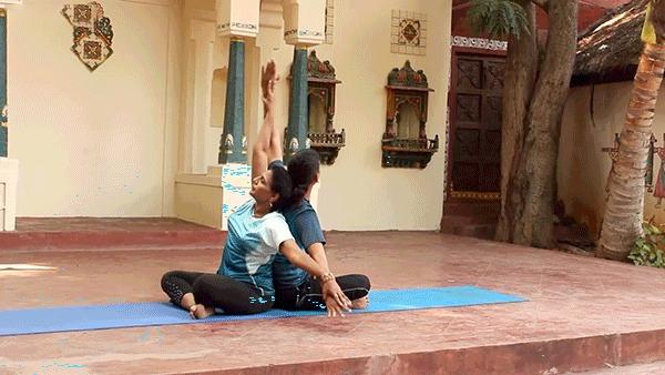 SEATED SIDE BEND – Parsva Sukhasana ( yoga poses for 2 people )