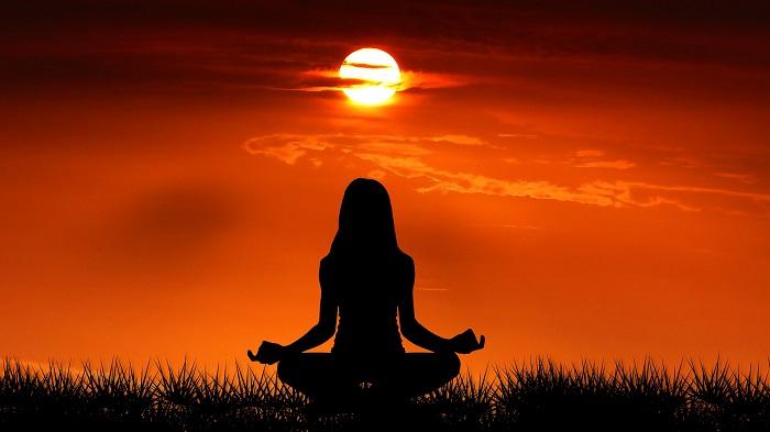 women doing yoga in sunrise